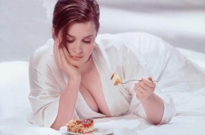 Woman guiltily eating