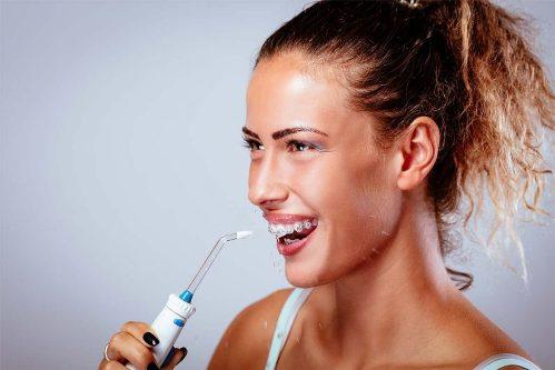 young-girl-washing-teeth-1024x683-1024x683 Новинка Revyline RL 800 - самый необычный портативный ирригатор